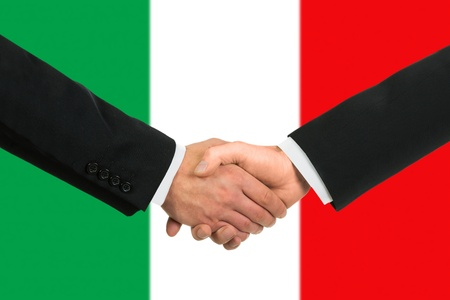The Italian flag and business handshake photo