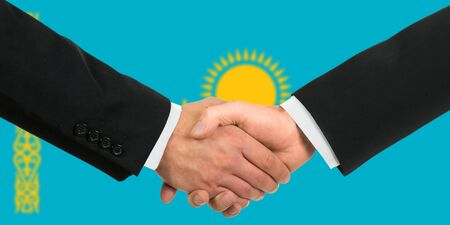 The Kazakh flag and business handshake photo