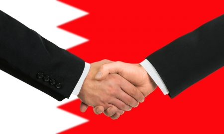 The Bahraini flag and business handshake Фото со стока