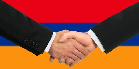 The Armenian flag and business handshake Stock Photo - 15411035