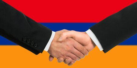The Armenian flag and business handshake Stock Photo - 15411035