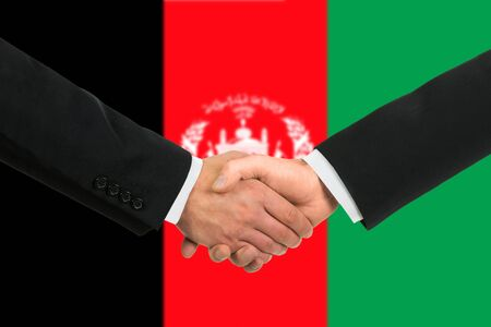 afghan flag: The Afghan flag and business handshake
