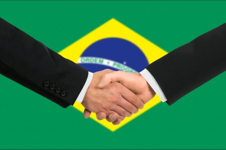 The Brazilian flag and business handshake photo