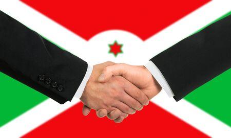 burundi: The Burundi flag and business handshake