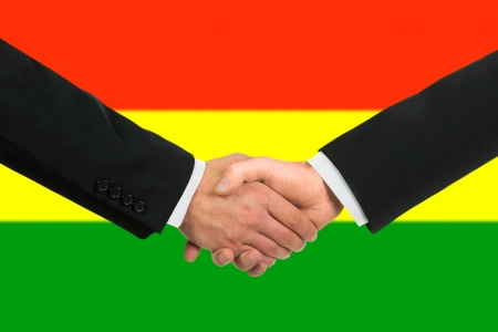 bolivian: The Bolivian flag and business handshake Stock Photo