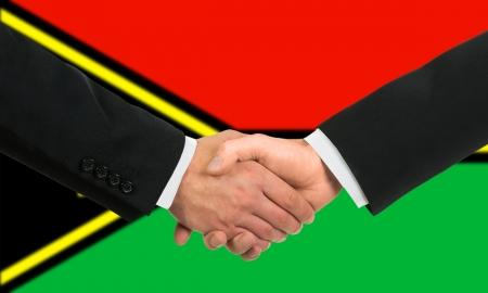 The Vanuatu flag and business handshake Stock Photo - 15411037
