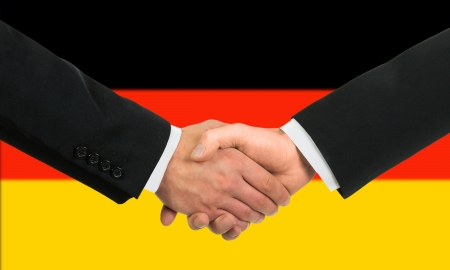 The German flag and business handshake photo
