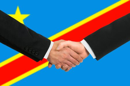 The Democratic Republic of the Congo flag and business handshake photo