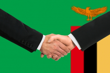 zambian: The Zambian flag and business handshake