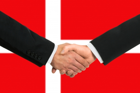 The Danish flag and business handshake photo