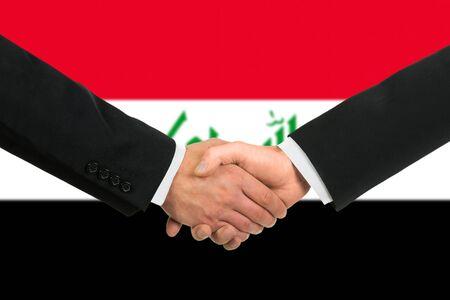 iraqi: The Iraqi flag and business handshake Stock Photo