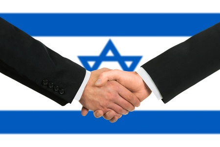 The Israeli flag and business handshake photo