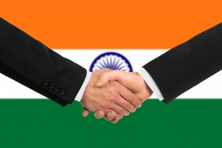 india flag: The Indian flag and business handshake Stock Photo