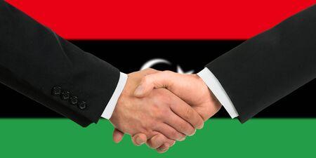 libyan: The Libyan flag and business handshake