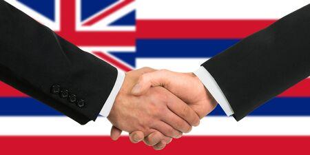 hawaii flag: The Hawaii flag and business handshake