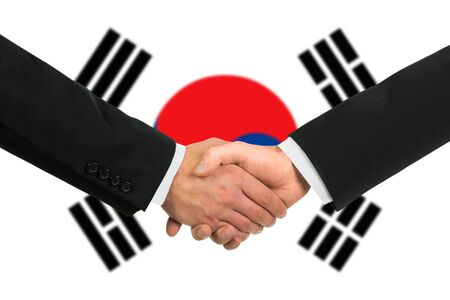 The South Korea flag and business handshake photo