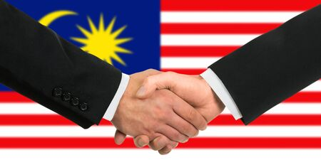 The Malaysia flag and business handshake photo