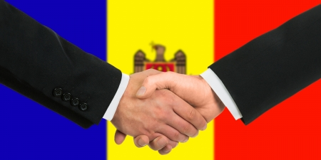 moldovan: The Moldovan flag and business handshake Stock Photo