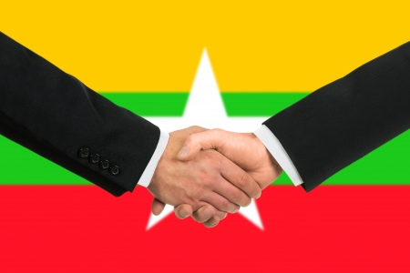 The Myanmar flag and business handshake photo