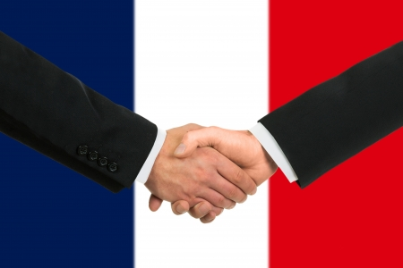 The French flag and business handshake photo