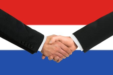 The Netherlands flag and business handshake photo
