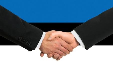estonian: The Estonian flag and business handshake Stock Photo
