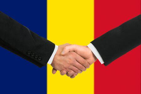 chad: The Chad flag and business handshake Stock Photo