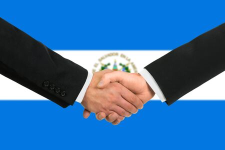 The Salvador flag and business handshake photo