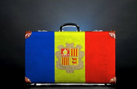 The Andorran flag on a suitcase for travel. photo