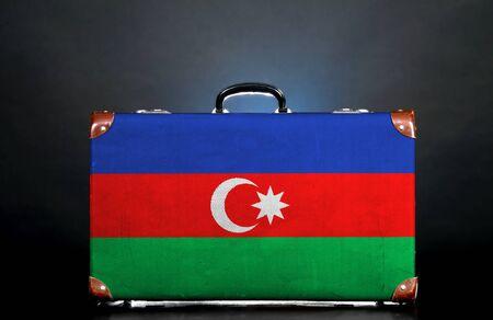 azerbaijani: The Azerbaijani flag on a suitcase for travel.
