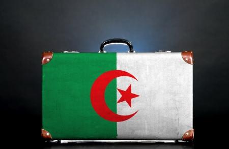 algerian flag: The Algerian flag on a suitcase for travel.