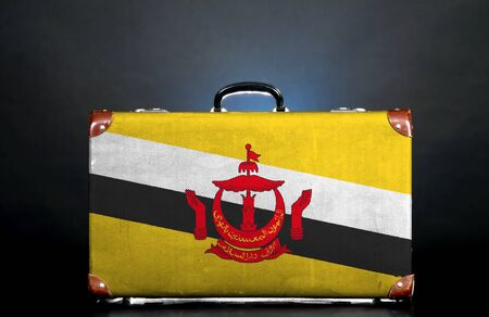 The Brunei Flag on a suitcase for travel. photo