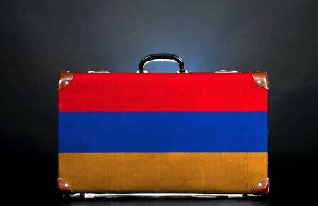 The Armenian flag on a suitcase for travel. photo
