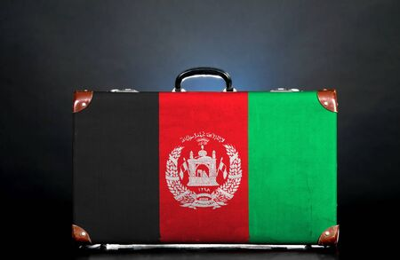 afghan flag: The Afghan flag on a suitcase for travel.