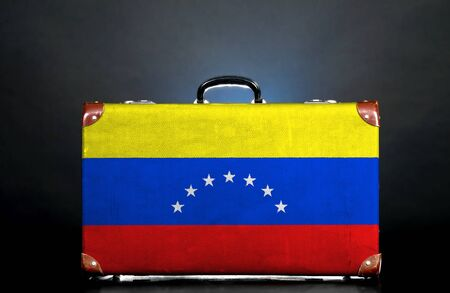 The Venezuelan flag on a suitcase for travel. photo