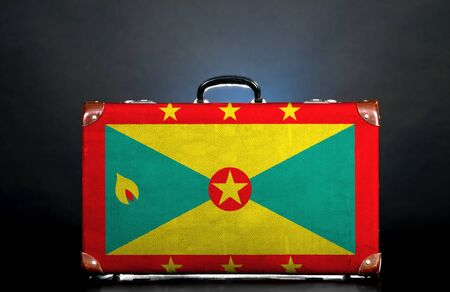 The Grenada flag on a suitcase for travel. photo