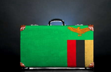 zambian flag: The Zambian flag on a suitcase for travel.