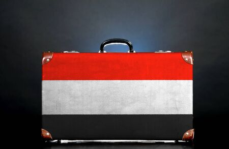 The Yemeni flag on a suitcase for travel. photo