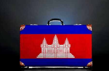 The Cambodian flag on a suitcase for travel. photo