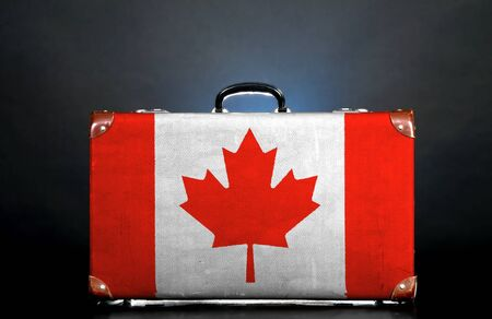 money vault: The Canadian flag on a suitcase for travel.