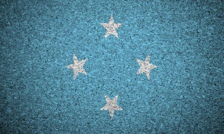 micronesia: The Micronesia flag painted on a cork board.
