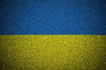 emblem of ukraine: The Ukrainian flag painted on a cork board.