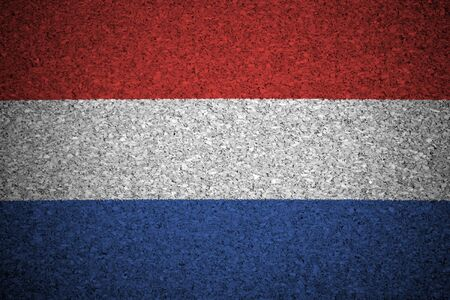 The Netherlands flag painted on a cork board. photo