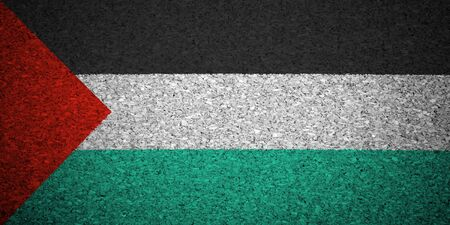 The Palestinian flag painted on a cork board. photo