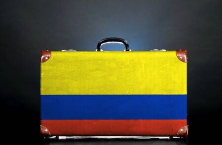 The Colombian flag on a suitcase for travel. photo