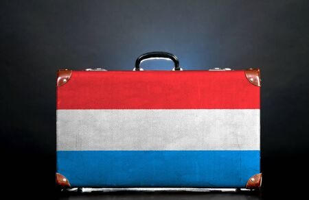 The Luxembourg flag on a suitcase for travel. photo