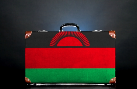 The Malawi flag on a suitcase for travel. photo
