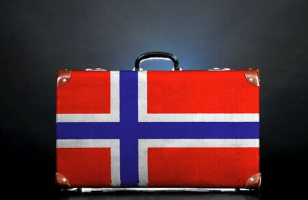 The Norwegian flag on a suitcase for travel. photo
