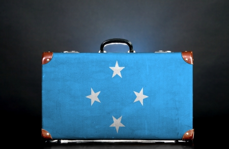 micronesia: The Micronesia flag on a suitcase for travel. Stock Photo