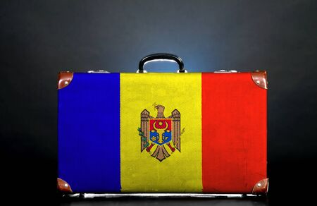moldovan: The Moldovan flag on a suitcase for travel. Stock Photo